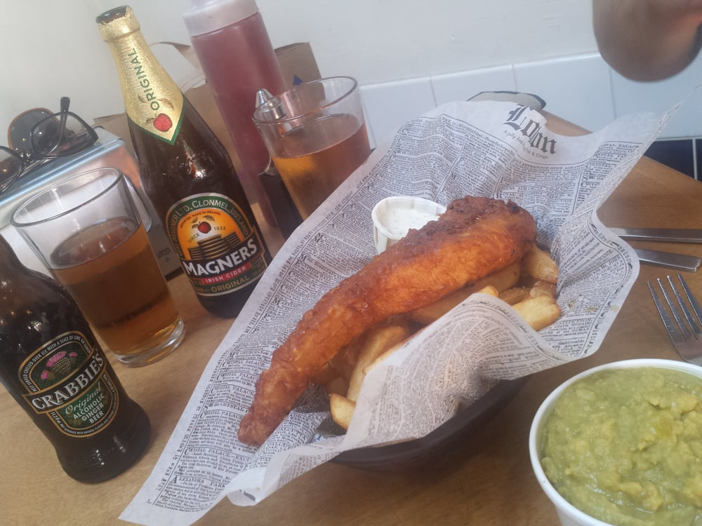 Fish and chips with a side of mushy peas coupled with a for Mac s fish and chips