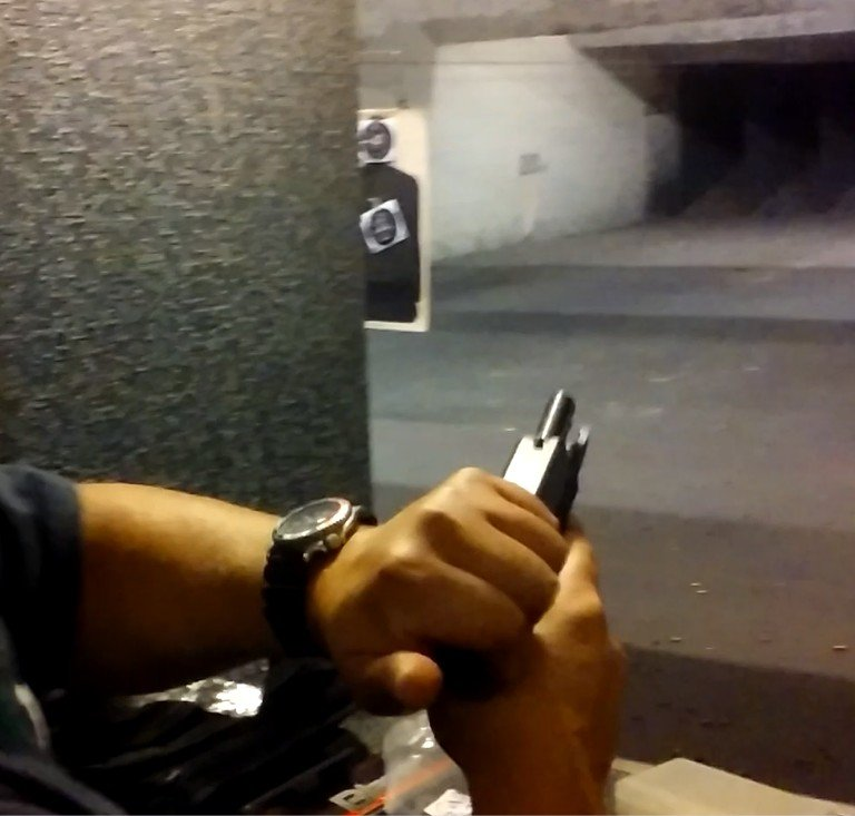 racking the slide on a Glock 19 pistol at The GUN ROOM - Yelp