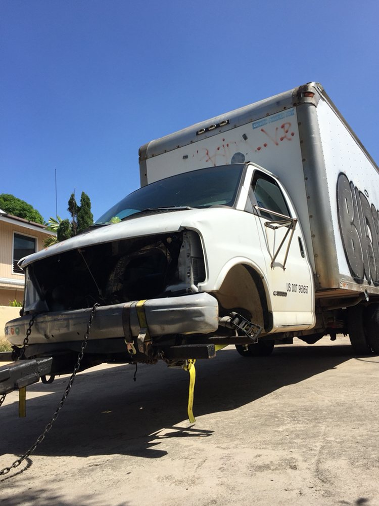Towing this box truck to the junkyard. - Yelp