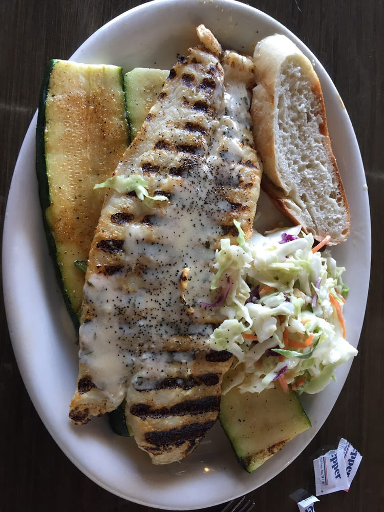 White fish in lemon butter sauce with grilled zucchini and for California fish grill
