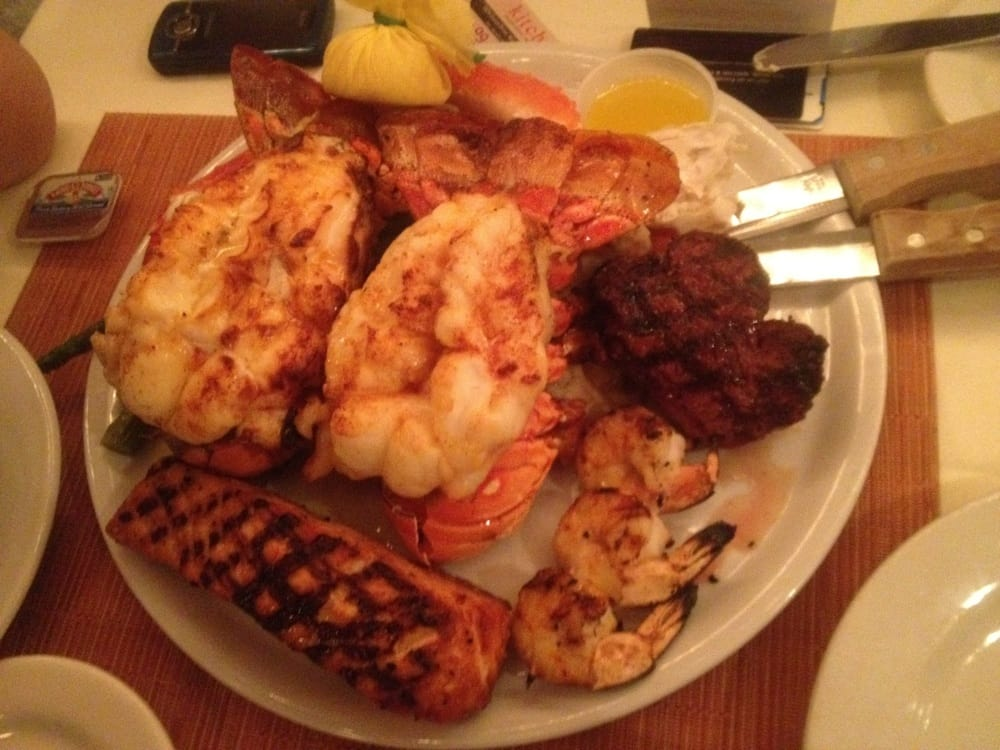 2 Lobster tail + 2 alaska king crab leg + 6 oz filet + salmon + grilled Sh + 2 sides !!! Off the ...