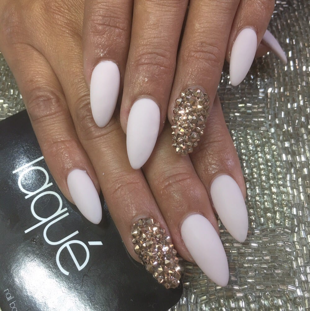 Almond shaped nails with rose gold swarovski crystals. Matte nail ...