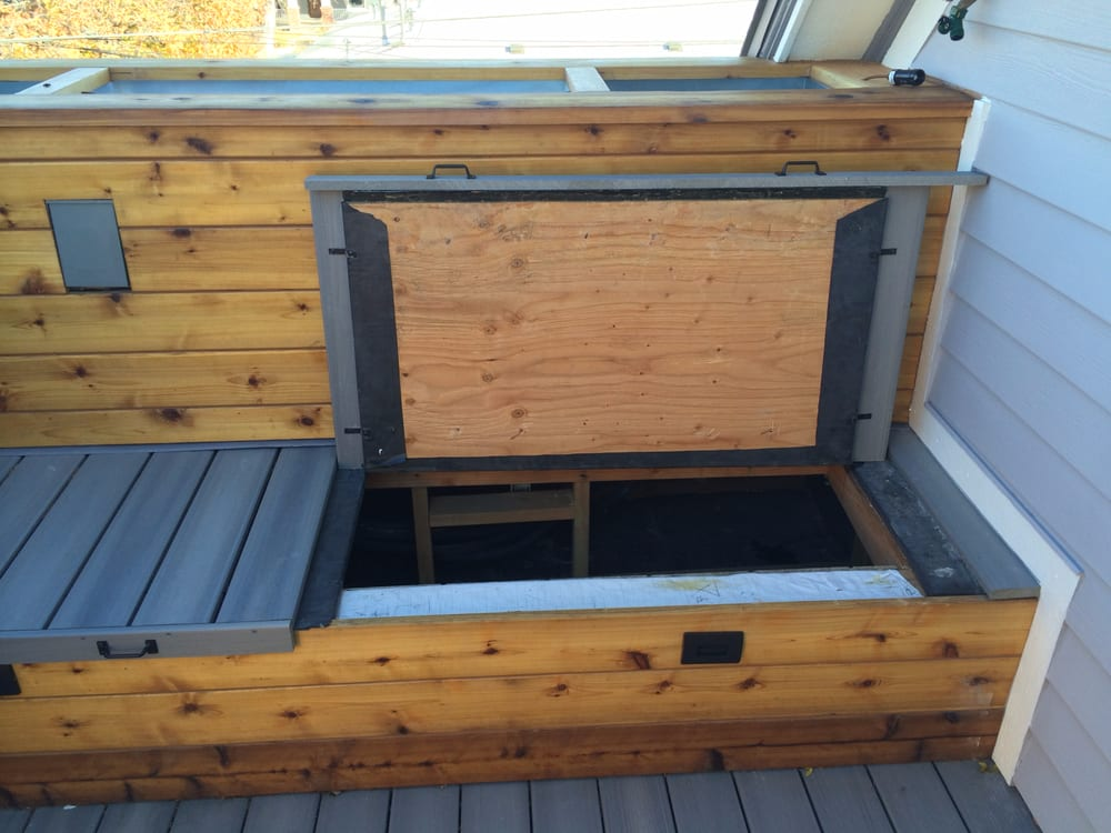 Deck Bench Hiding Air Conditioning Unit And Holding Three