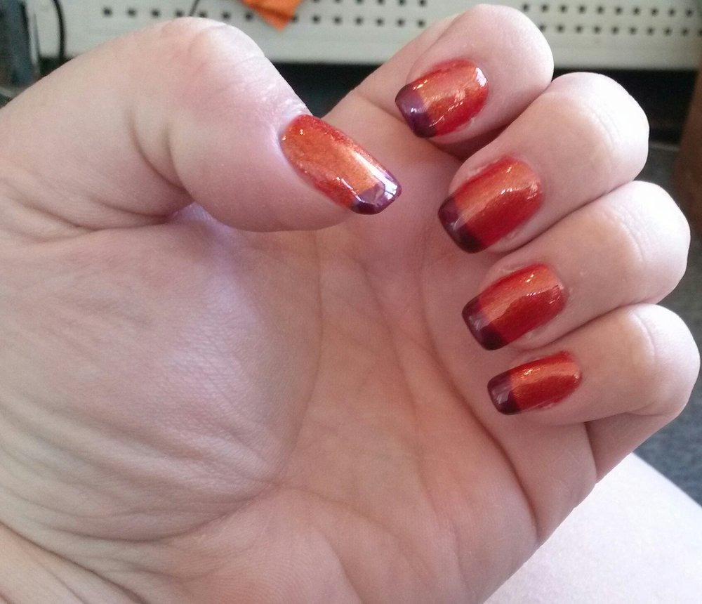 My first set of fall nails, in sparkly orange with dark purple tips ...