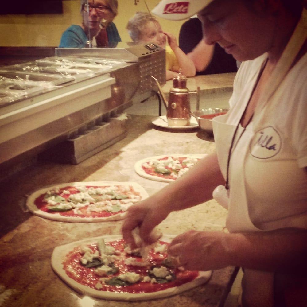 Nella Making Pizza Margherita At The Open Kitchen