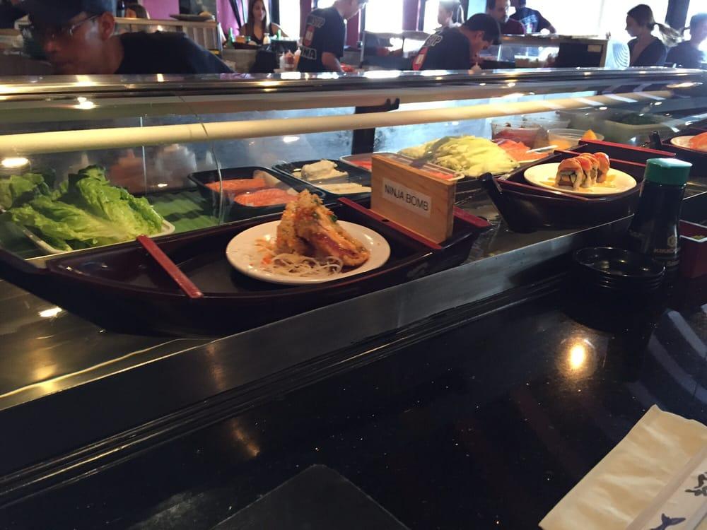 Ninja spinning sushi bar 185 photos restaurant - Restaurant japonais cuisine devant vous ...