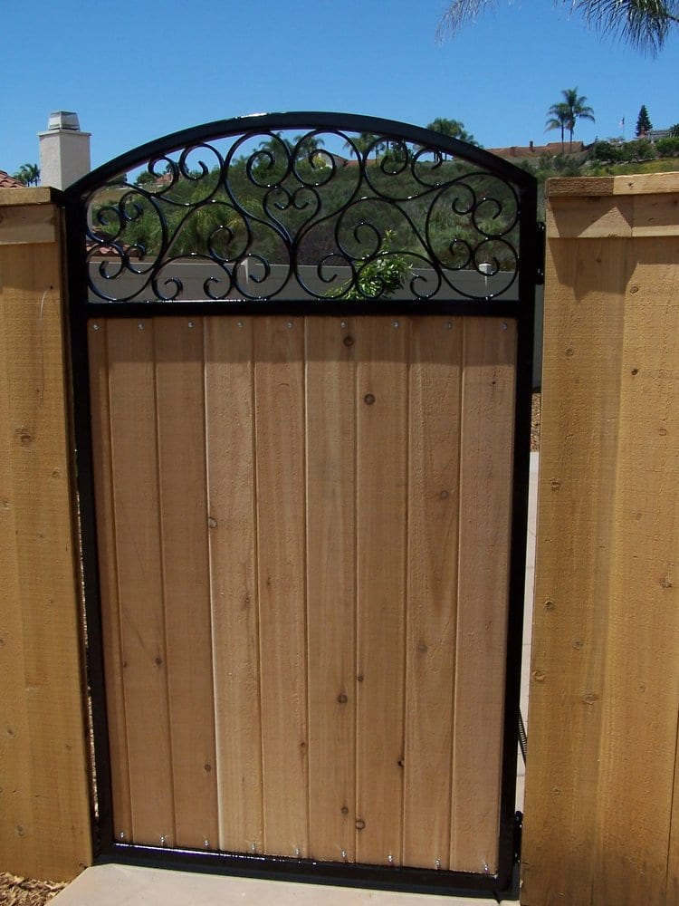Decorative iron walk gate with wood inlaid yelp