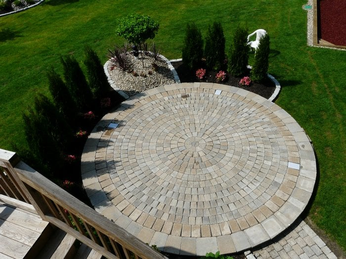 Photo of Done Right Landscape - Newton, MA, United States. Circular Paver  Patio - Circular Paver Patio With Planting And Stonescaping Around Border - Yelp