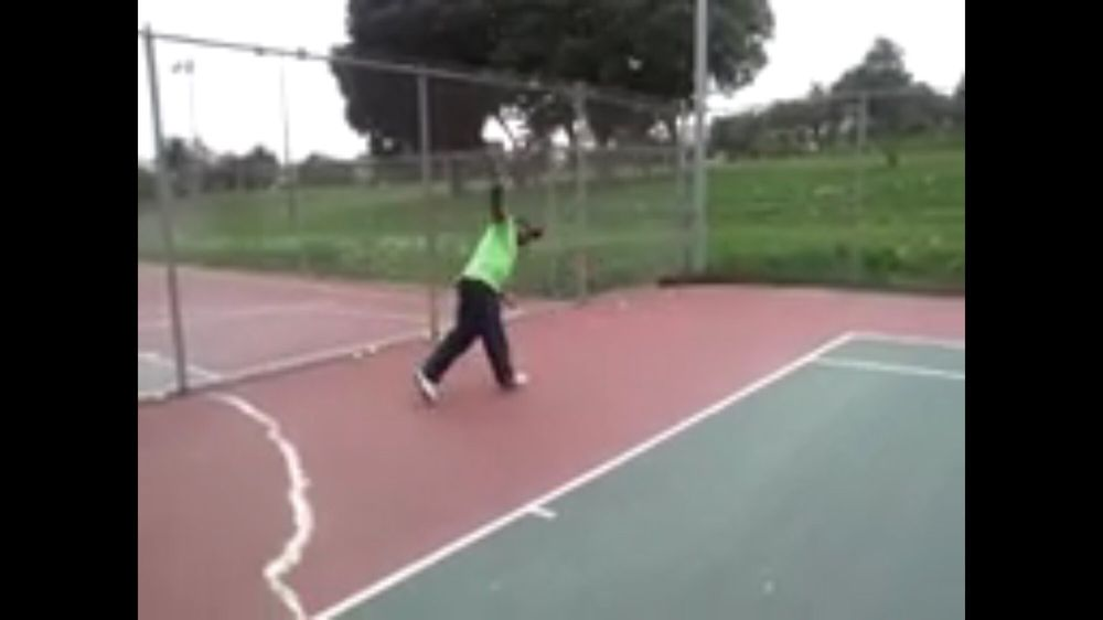 Photo of Tennis Lessons By Mcclain - San Francisco, CA, United States. The follow through is complete, this is how you should look after finishing your single backhand follow through Full extension