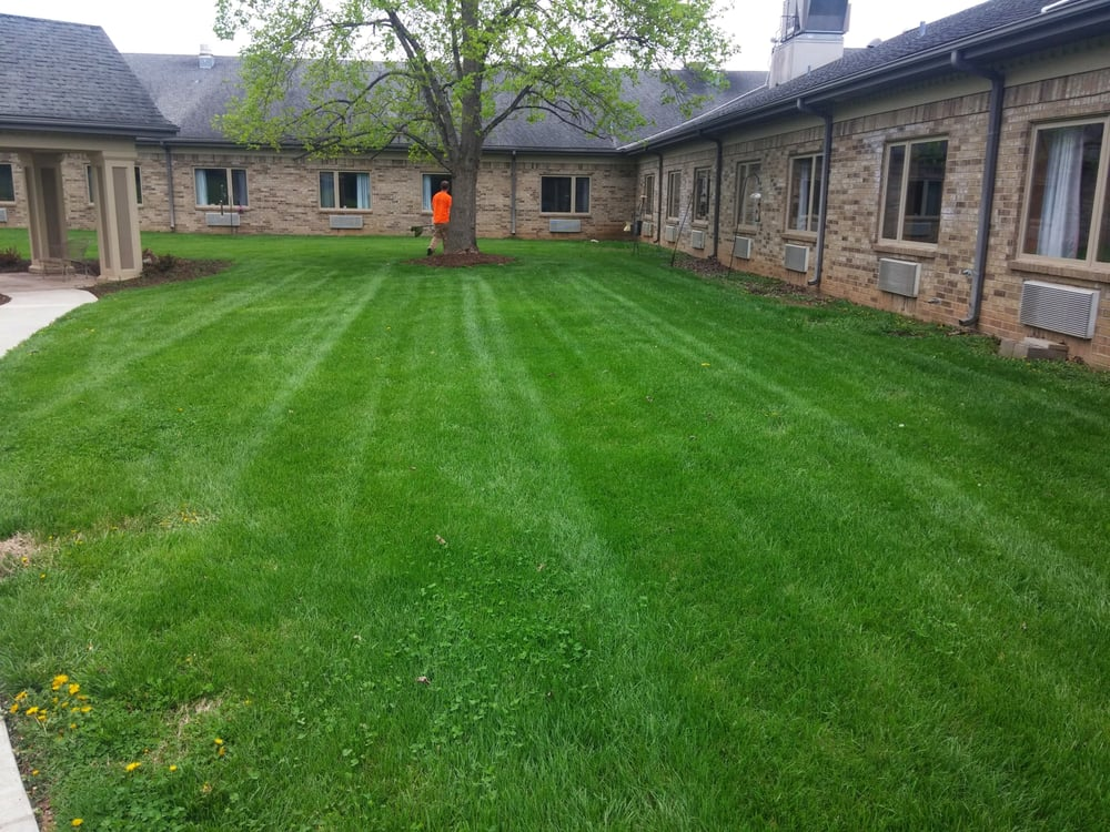 Landscaping Boulders Springfield Mo : Custom edge lawn care and snow removal landscaping