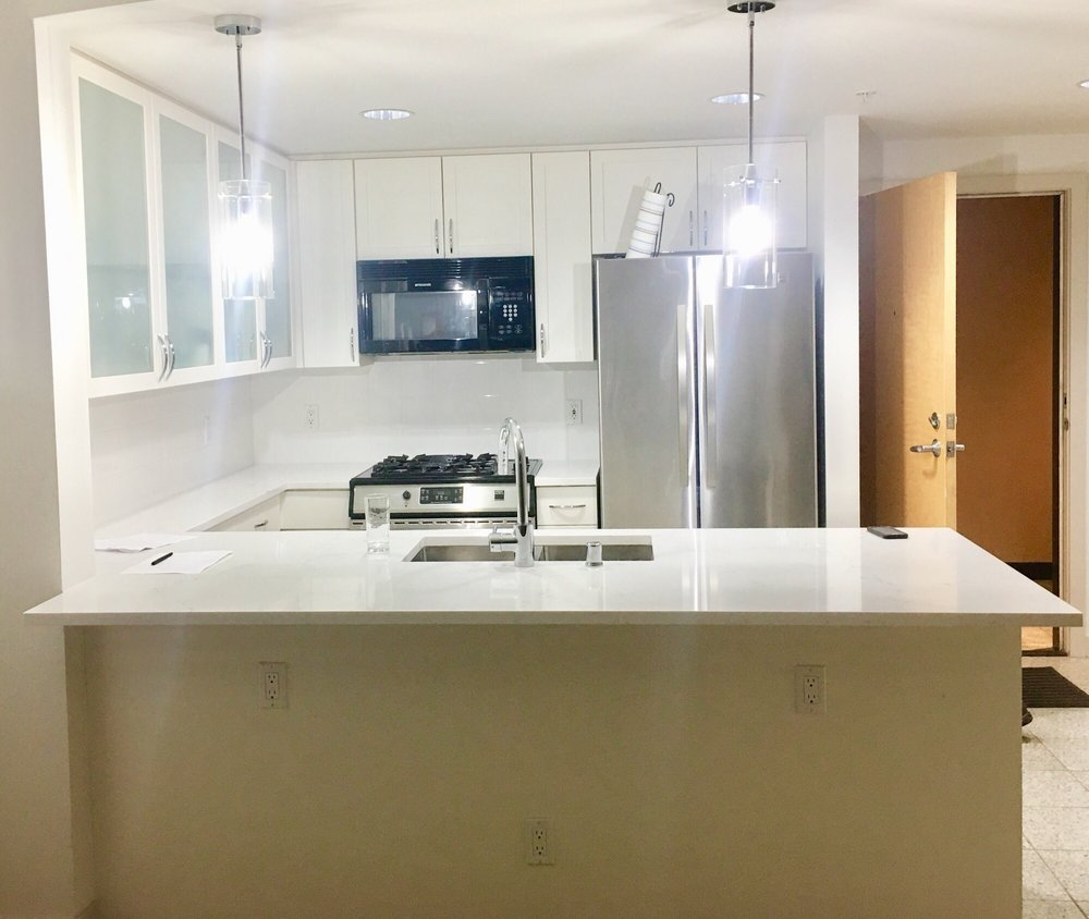 The finished kitchen counter with new faucet and sink - Yelp
