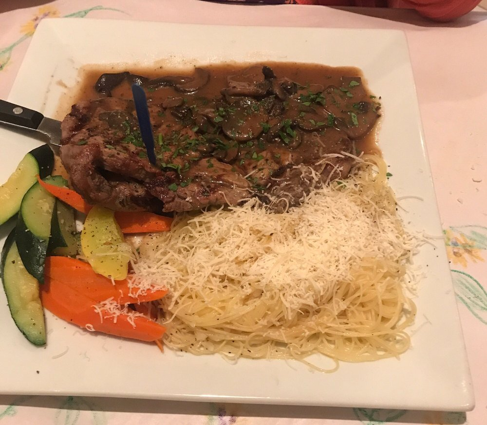 Bistechina Alla Griglia Grilled Rib Eye Steak Topped With A Sauteed