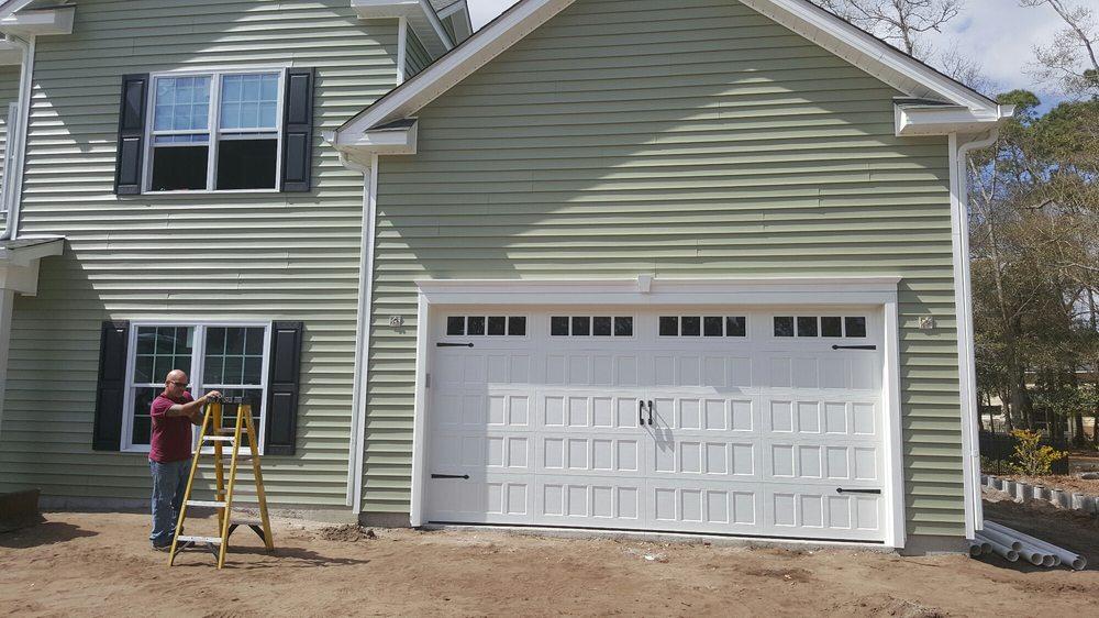 A a garage door solutions 10 foto servizi per porte di for 2 piedi quadrati per garage