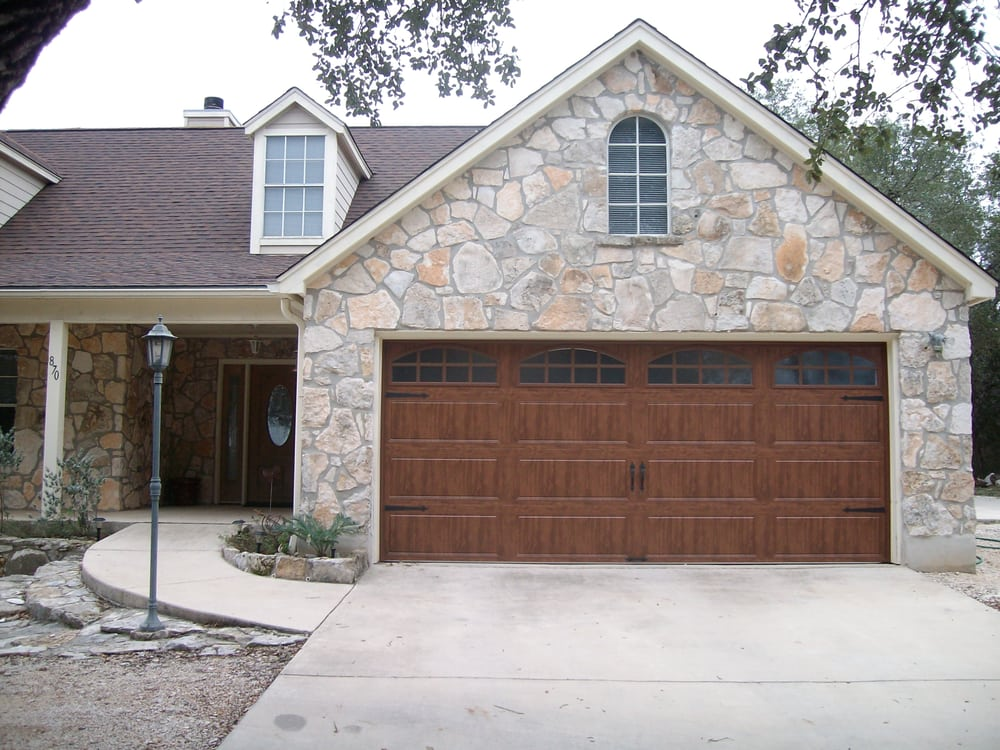 The popular clopay galley series ultra grain in dark oak for Clopay steel garage doors
