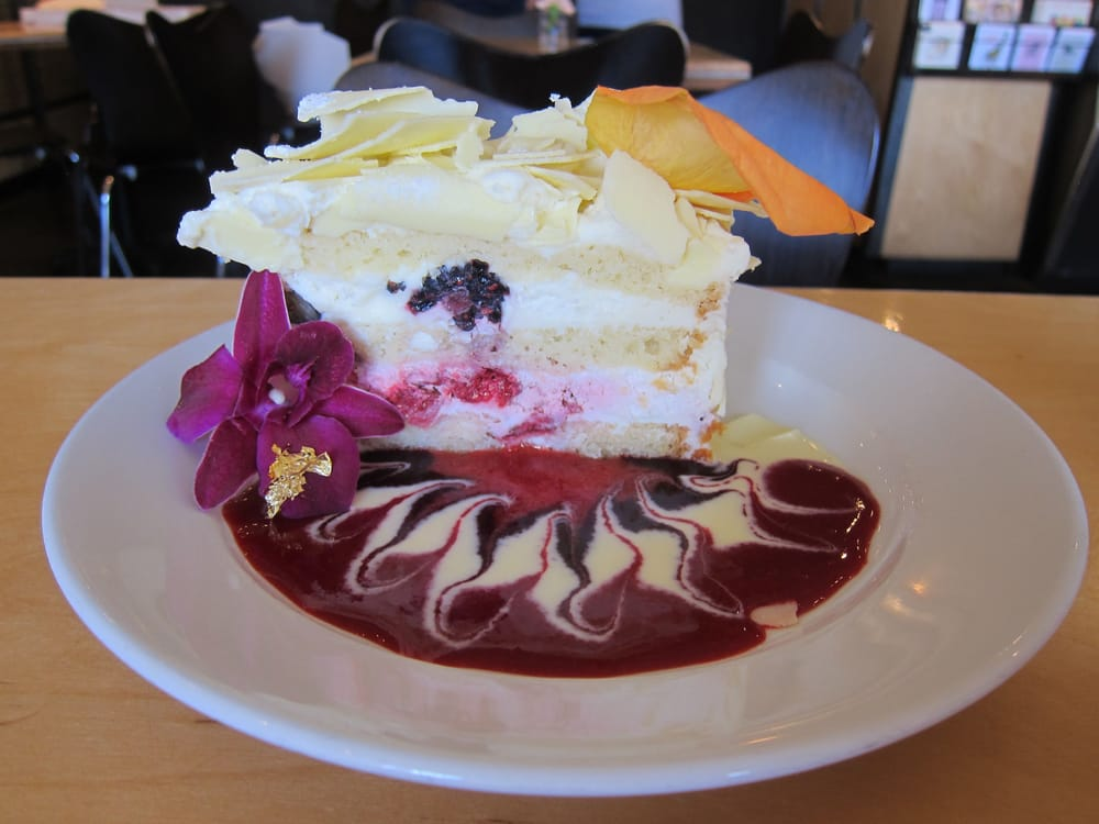 ... Cake layered with creamy white chocolate mousse, Raspberry, Strawberry