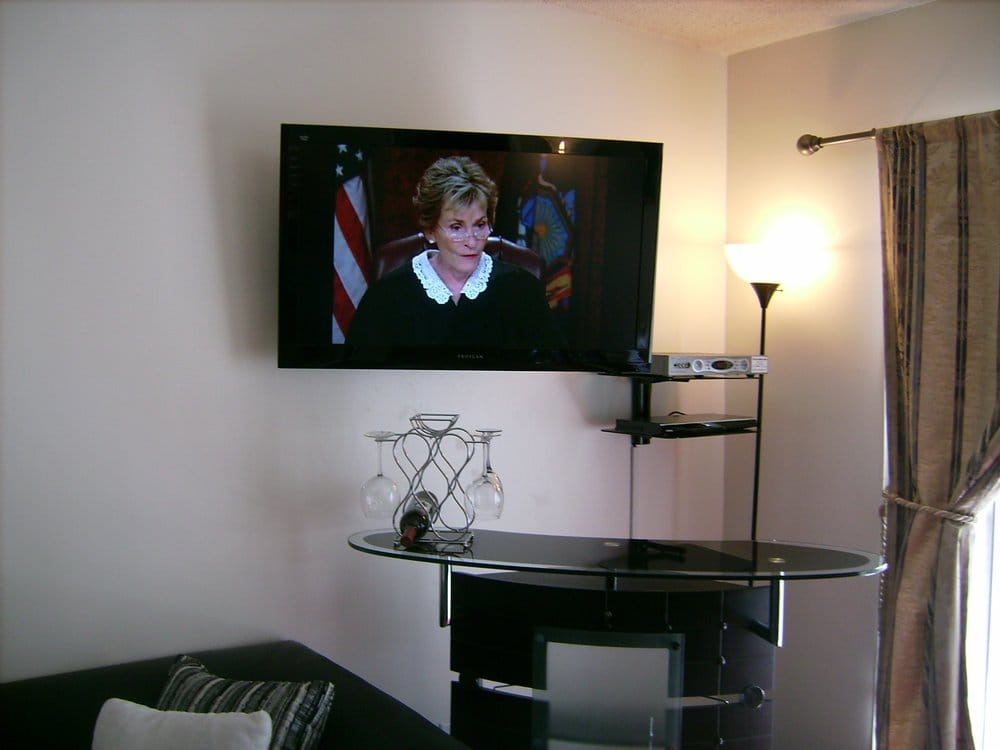 premium tv installation on a swivel wall mount above bar. Black Bedroom Furniture Sets. Home Design Ideas