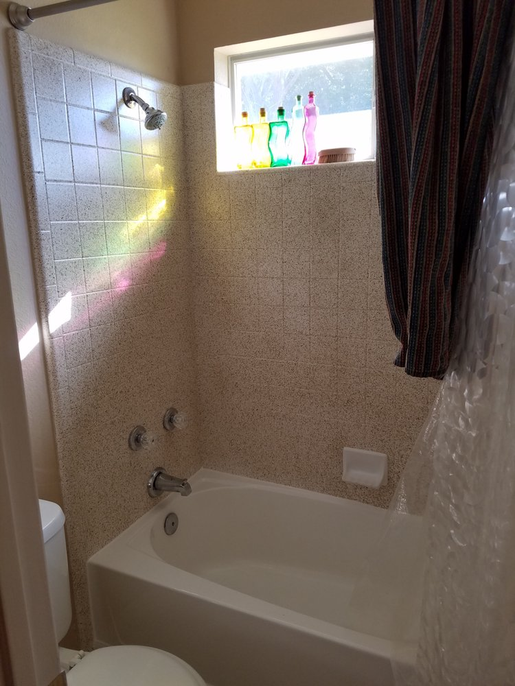 This bathtub was perpetually grey and dirty because the glazing had ...