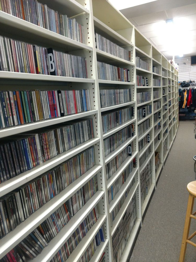 Giant wall of used CDs - Yelp