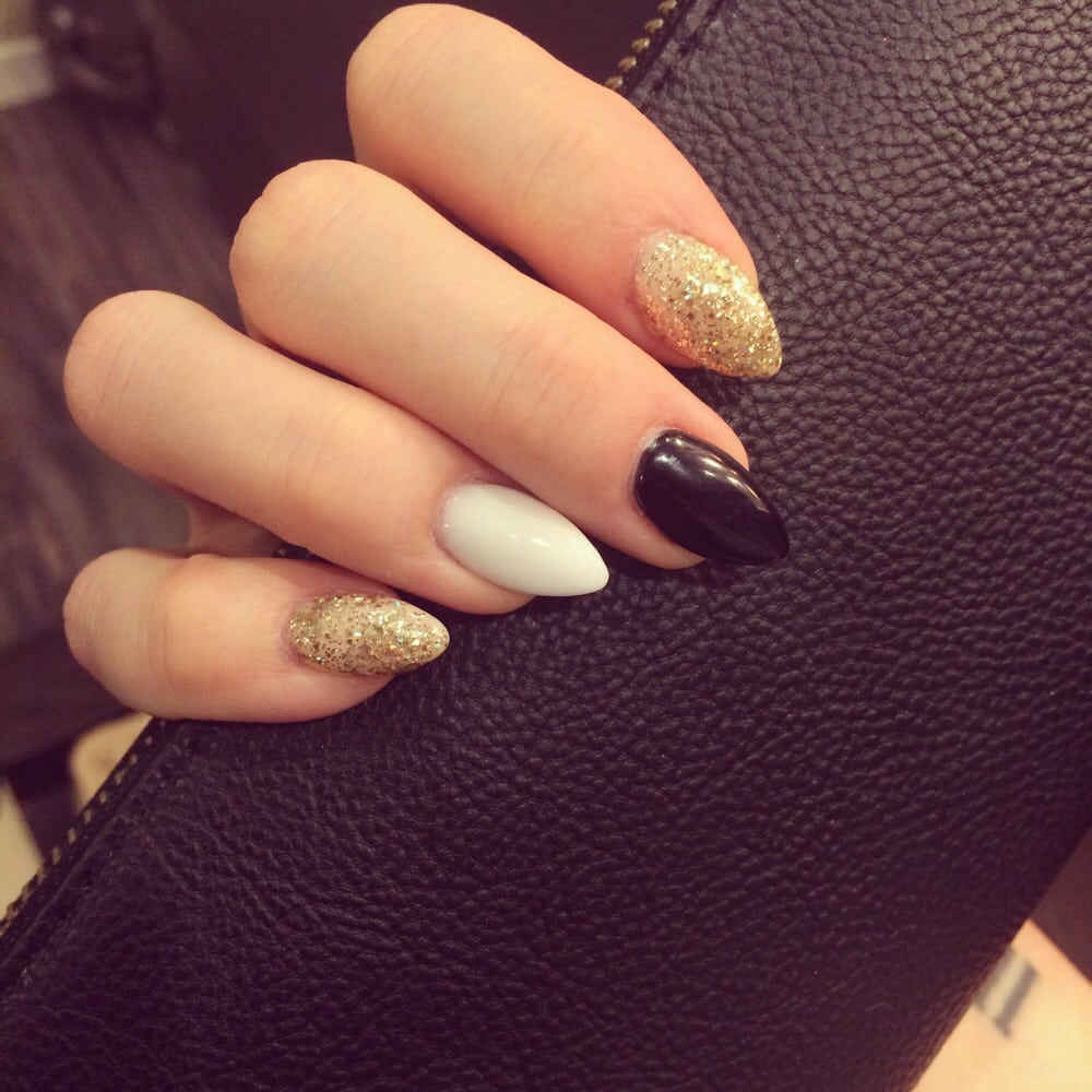 Great short stiletto nails! Gold and black for the Saints! - Yelp
