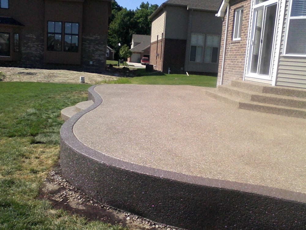 Raised exposed aggregate patio with accent border