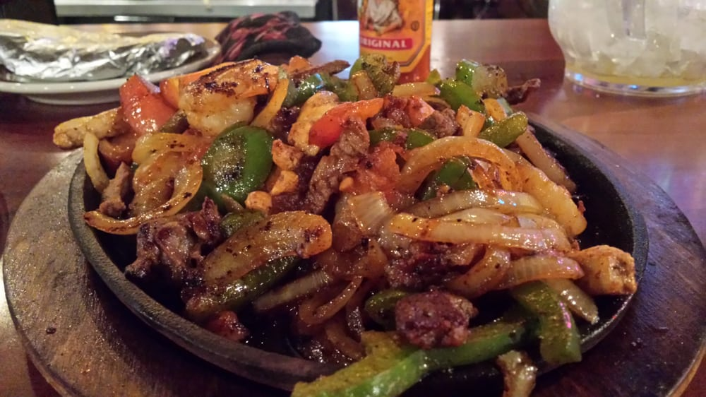 Texana Fajitas; Featuring Steak , Chicken, and Shrimp. They have Lobster Fajitas too. - Yelp