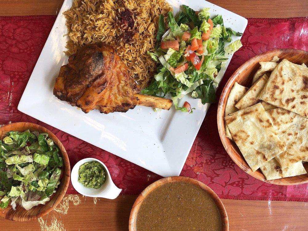 Photo of Z Zoul Cafe - San Francisco, CA, United States. Roasted Lamb Shank w/ rice, salad ($14.80) & Sudanese Daily Special: Ground Meat + Okra Stew w/ gorrasa bread, salad ($11.80)