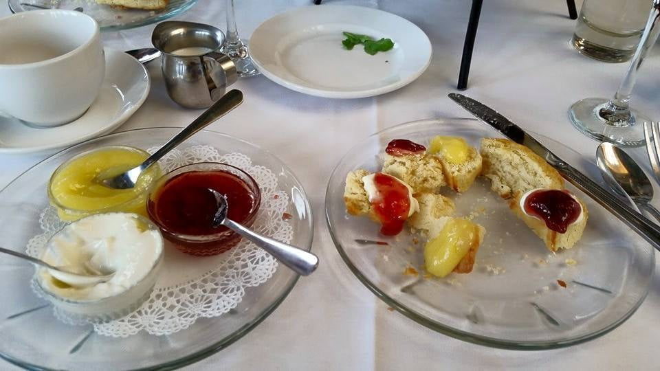 Photo of Boulder Dushanbe Teahouse - Boulder, CO, United States. cream, strawberry jam and lemon curd for the scones