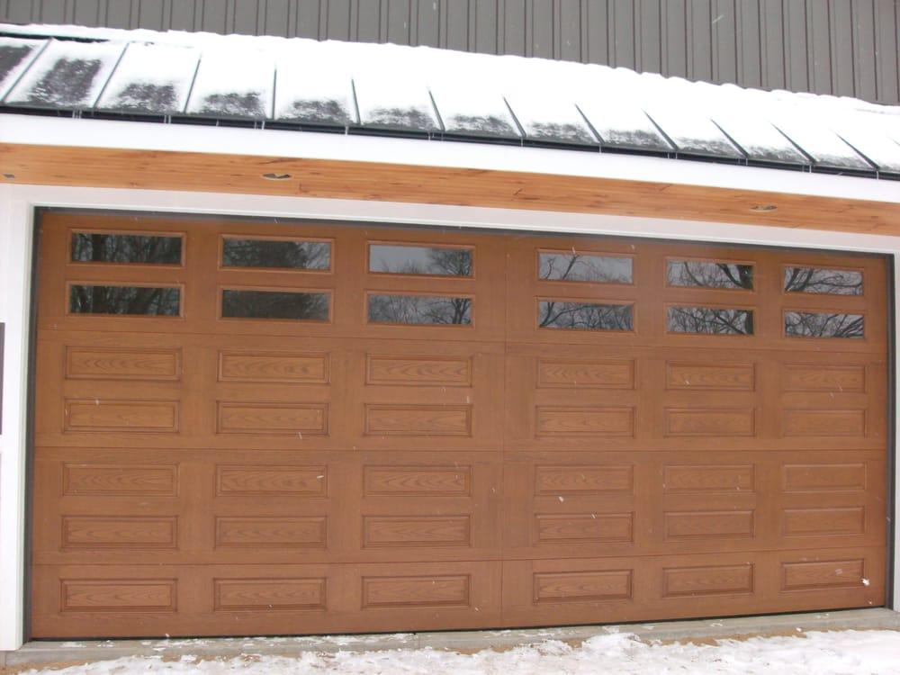 & Wayne-Dalton #9700 Camden panel style in Walnut stain finish. - Yelp pezcame.com