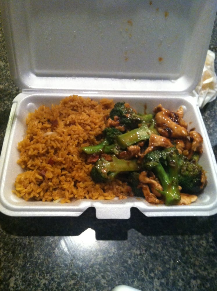 Chicken and broccoli in brown sauce with pork fried rice ...