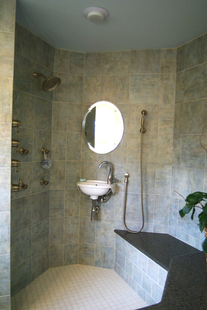 a walk-in shower with body jets, shaving sink, heated mirror and ...