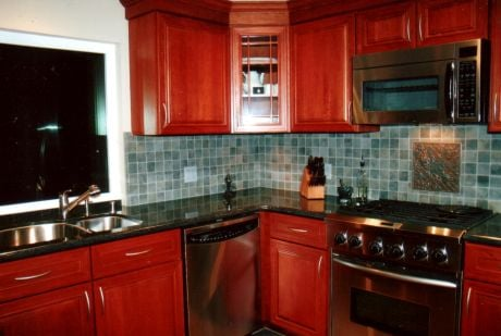 New Cherry Cabinets Appliances Granite Tops With Mosaic Tile Backsplash Yelp