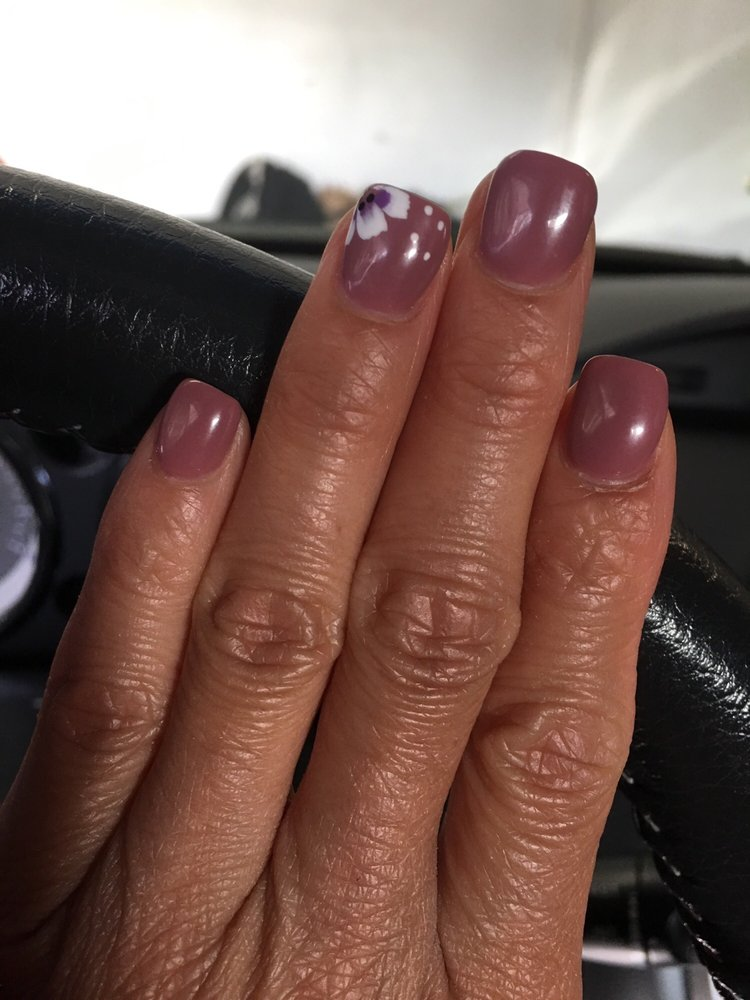 Gel nail with pretty nail art on ring finger - Yelp