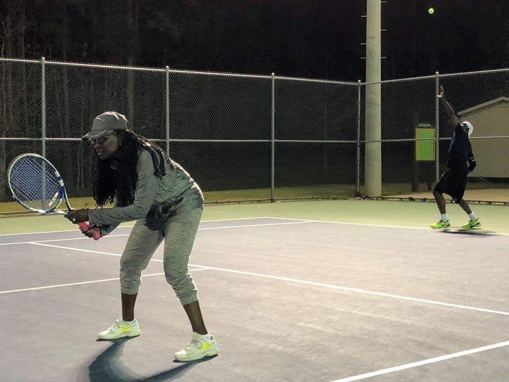 Photo of Tennis Lessons By McClain - San Francisco, CA, United States. Brother and wife playing doubles
