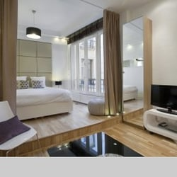 All paris apartments hotels 26 26 rue de la p pini re saint lazare grands magasins paris for All paris apartments
