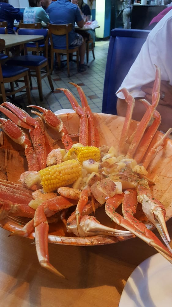 12 snow crab legs, with an extra cluster of snow crab legs, 12