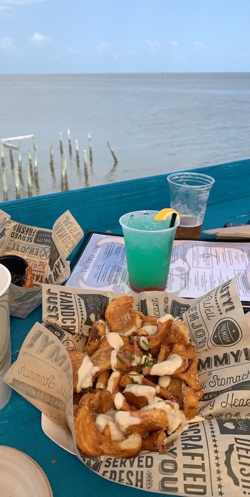 The Tipsy Cow Bar and Grill: 360 Dock St, Cedar Key, FL