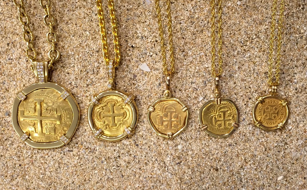 A collection of gold coin pendants including 12 1 2 4 and 8 photo of treasure chest coin company honolulu hi united states a collection aloadofball Images