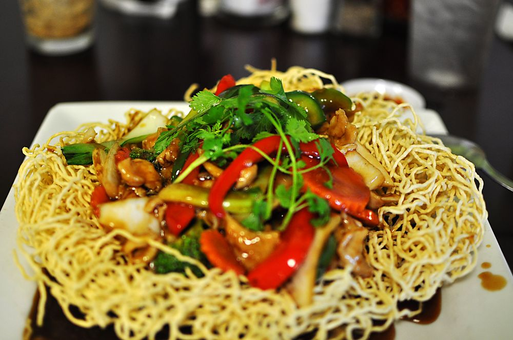 Photo of Saigon Noodle and Grill - Orlando, FL, United States. K4 - Crispy yellow egg noodle stir fried with vegetables, shrimp, beef, pork, and squid