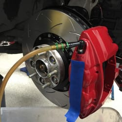 Enthusiast Auto Care - Concord, CA, United States. Eugene installing the sport brakes on my regular G35X sedan. Had the brakes power-coated and Eugene was very careful