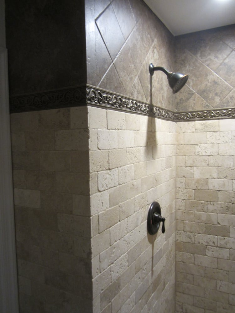 Tumbled Marble Shower With Floating Corner Bench And Tile