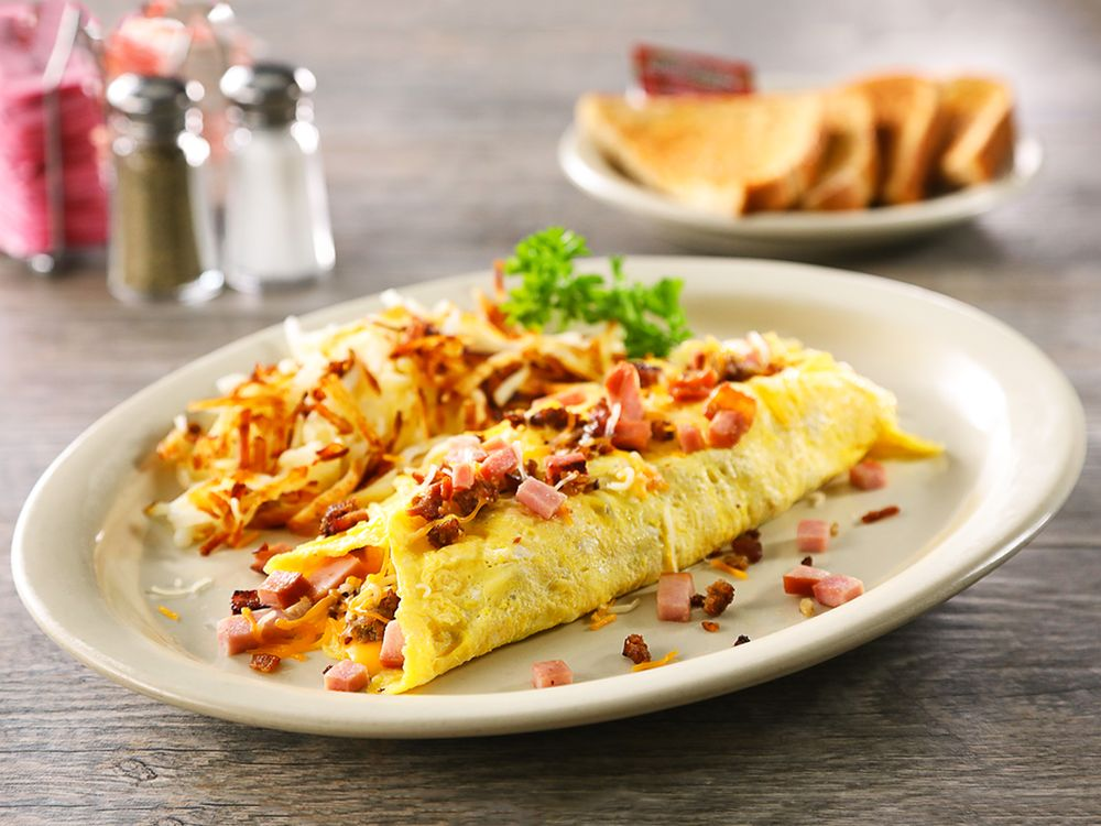Texas Omelet - Stuffed with bacon, sausage, diced ham and