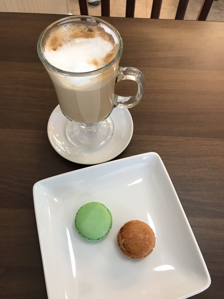 Photo of Dolce and Bean - Alexandria, VA, United States. Delicious cappuccino and macaroons.
