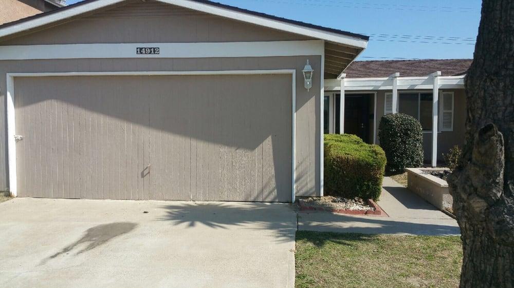Replace old wooden door to new sectional garage door for Local garage door