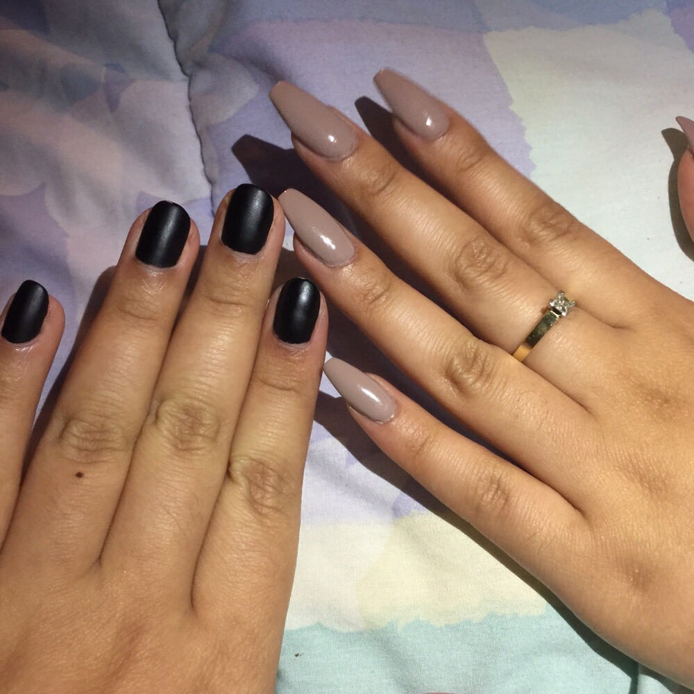 Natural rounded nails with a black matte polish and a full set of ...