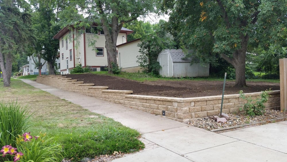 This corner lot retaining wall using anchor highland wall for Sd garden designs