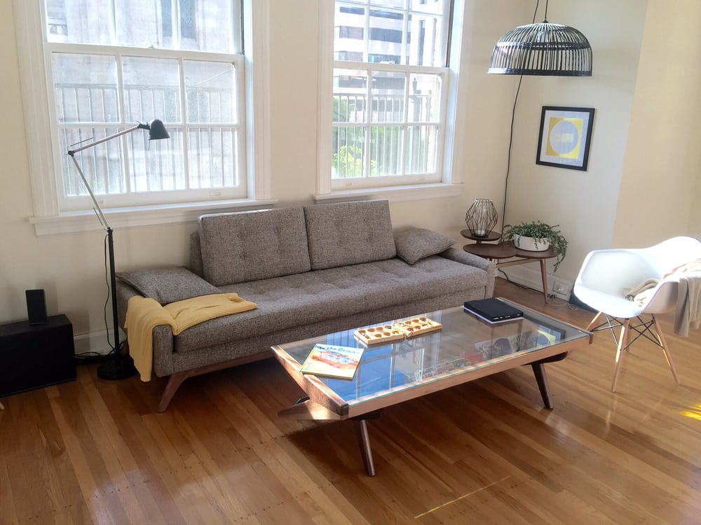 The couch and game magazine coffee table are from their