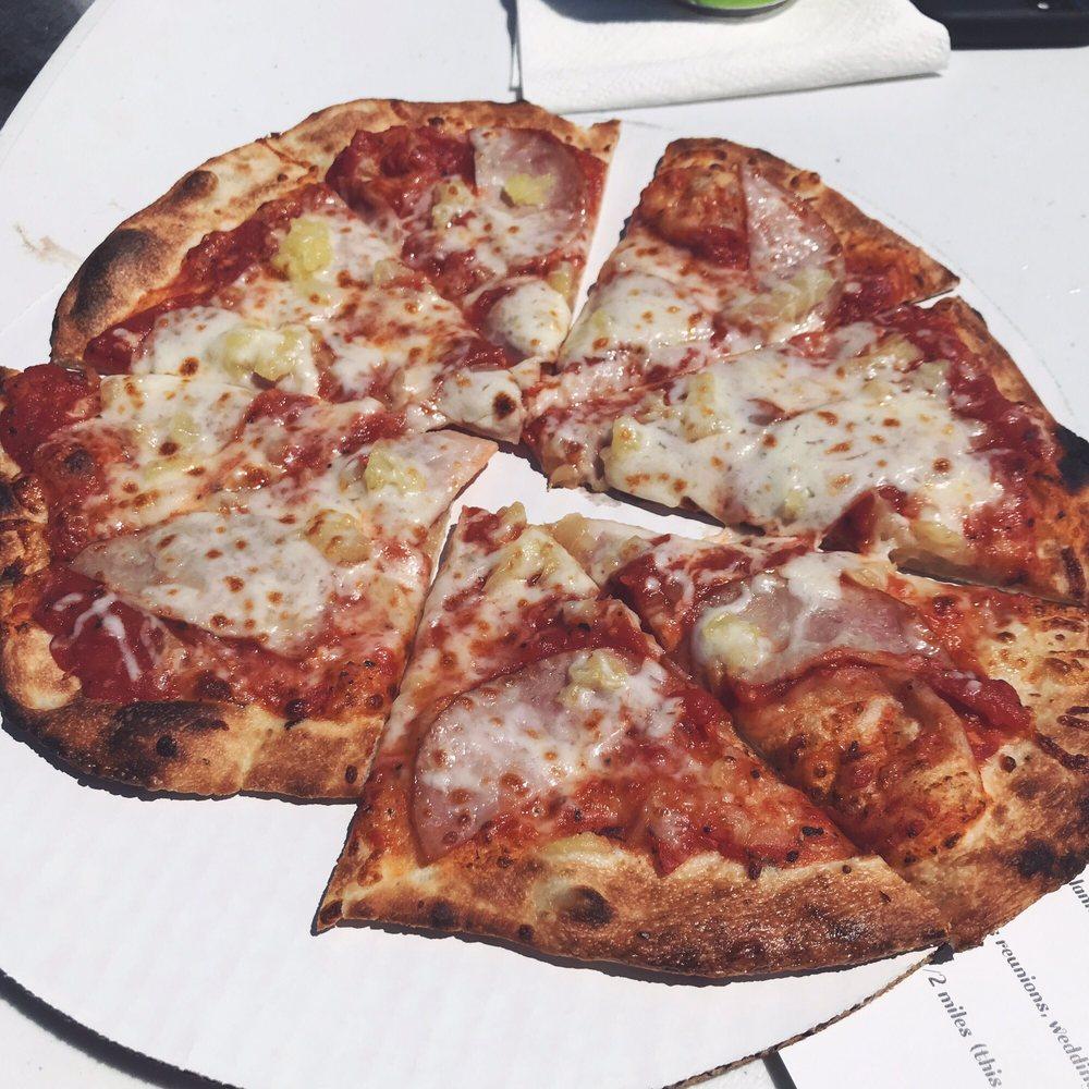 Stone Wall Pizza: 3297 320th St, Wellman, IA