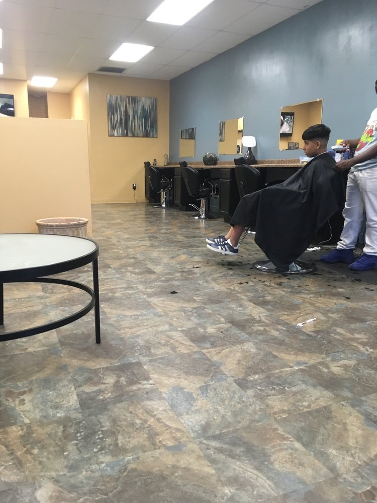 Cuts and Curls Barber and Beauty Lounge: 11336 Bartlett Rd, Adelanto, CA