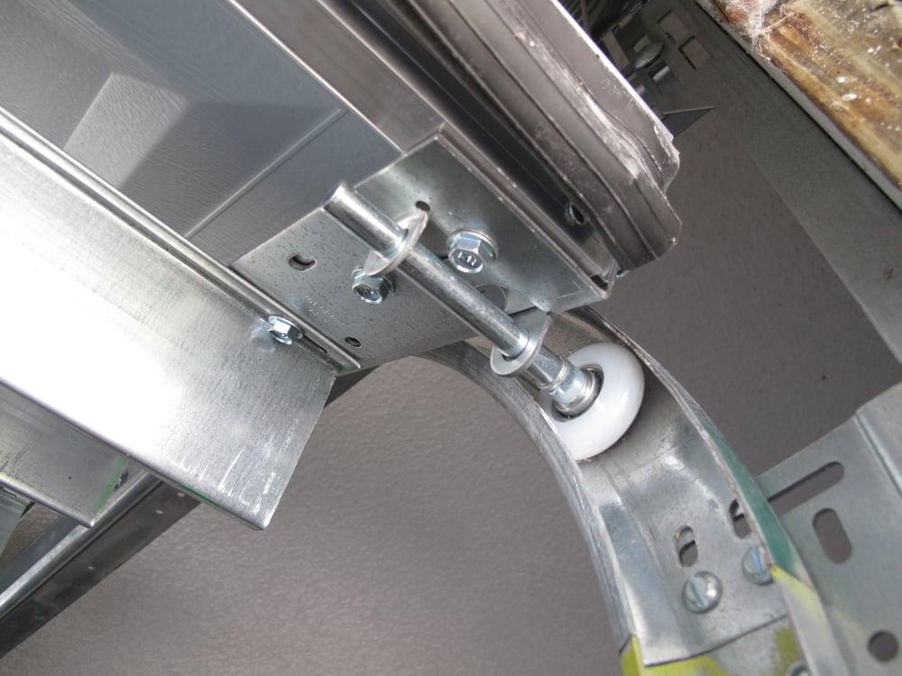 Nylon rollers will make door operate smoothly yelp for Garage door repair bradenton