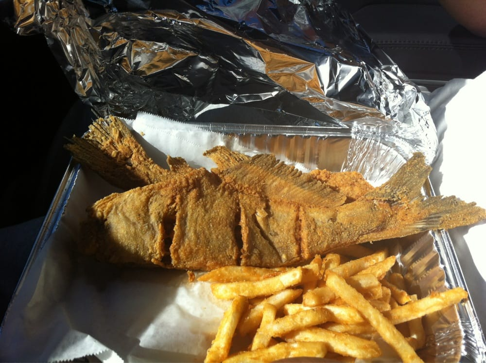 Catfish dinner served in a aluminum pan with foil yelp for Jj fish and chicken near me